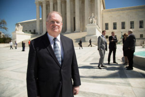 Reed at SCOTUS with background attys clients