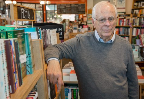 Elderly man in library