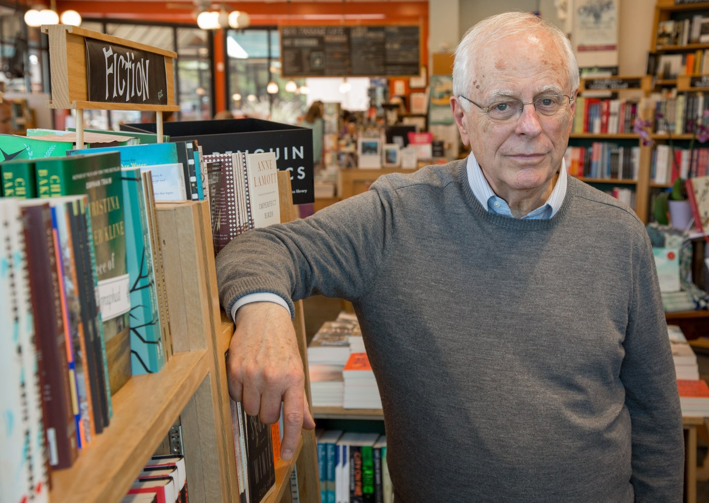 Elderly man in library